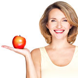 Portrait of a young smiling healthy woman with apple Stock Photos