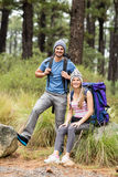 Portrait of a young smiling hiker couple Royalty Free Stock Images