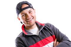 Portrait of young smiling man. Portrait of young man in sport hat over white Royalty Free Stock Photos