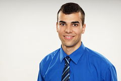 Portrait of young smiling man. In blue shirt, left you can write some text Royalty Free Stock Photo