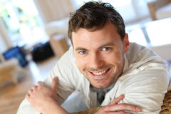 Portrait of young smiling man relaxing at home Stock Image