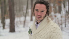 Portrait of Young Smiling Man in Winter Forest stock footage