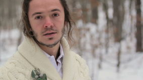 Portrait of Young Smiling Man in Winter Forest stock video