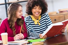 portrait of young smiling multicultural students doing stock photo