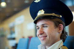 Portrait of young smiling pilot sitting in the air stock photo