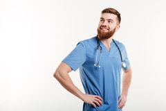 Portrait of a young smiling positive man doctor with stethoscope Stock Image