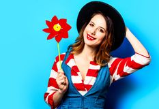 Smiling woman with red pinwheel stock photography