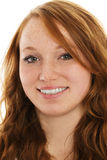 Portrait of a young smiling redhead woman Stock Images