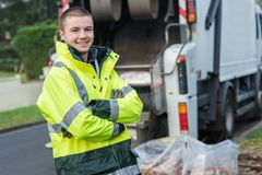 Free Portrait Young Smiling Refuse Collector Royalty Free Stock Photography - 103624837
