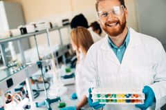 Portrait of young scientist posing in lab. Portrait of young smiling scientist posing in lab Royalty Free Stock Image