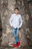 Portrait of young smiling Teen Boy looking at camera with a joyful smiling expression. White shirt on the child. Concept of child royalty free stock photography