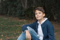 Portrait of young smiling Teen Boy looking at camera with a joyful smiling expression. Teenager confident and smart. copy space royalty free stock photography