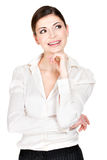 Portrait of the thinking woman  in white shirt Royalty Free Stock Photos
