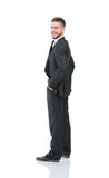 Portrait of the young  smiling turned businessman isolated on a Royalty Free Stock Image