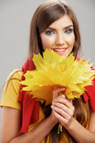 Portrait of young smiling woman, autumn leaves. Royalty Free Stock Photos