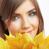 Portrait of young smiling woman, autumn leaves. Stock Image
