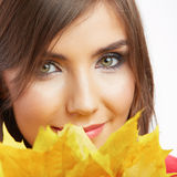 Portrait of young smiling woman, autumn leaves. Stock Photos