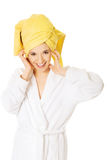 Portrait of young smiling woman in bathrobe Royalty Free Stock Photos