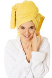 Portrait of young smiling woman in bathrobe Stock Photos
