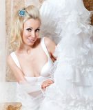 Portrait of the young smiling woman of the blonde with a white wedding dress Royalty Free Stock Photo