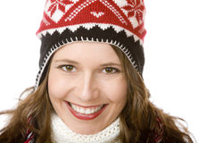 Portrait of young smiling woman with cap and scarf Stock Photo