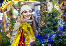 Portrait of young smiling woman at Christmas fair Stock Image