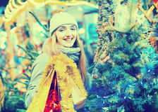 Portrait of young smiling woman at Christmas fair Royalty Free Stock Photos