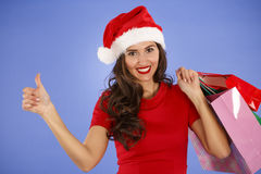 Portrait of a young smiling woman doing shopping before christma Stock Image