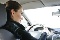 Portrait of young smiling woman driving car Royalty Free Stock Photos