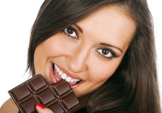 Portrait of young smiling woman eating chocolate Stock Photo