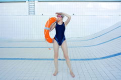 Portrait of young smiling woman in the empty swimming pool Stock Photography