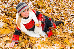 Portrait of young smiling woman on the ground Royalty Free Stock Image
