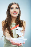 Portrait of young smiling woman hold white paper ship. Female m Royalty Free Stock Photography