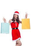 Portrait of a young smiling woman holding shopping bags before c Stock Photos