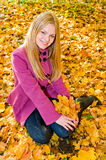 Portrait of young smiling woman on the leaves Stock Photo