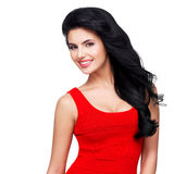 Portrait  of  young smiling woman with long brown hair. Portrait of beautiful face of an young smiling woman with long brown hair in red dress Stock Images