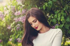 Portrait of young smiling woman outdoors Stock Images