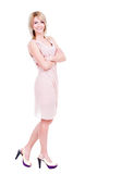 Portrait of young smiling woman in pink dress. Stock Photos