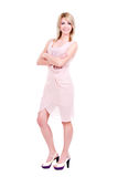 Portrait of young smiling woman in pink dress. Stock Image