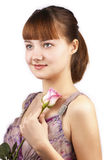 Portrait of young smiling woman with pink rose. Isolated on a white background stock images