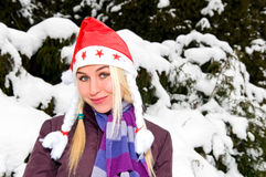 Portrait of young smiling woman in red cap Stock Image
