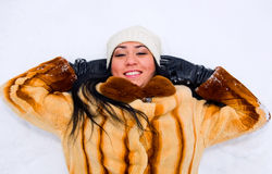 Portrait of young smiling woman on the snow royalty free stock photography