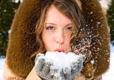 Portrait of young smiling woman with snow stock photos