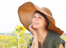 Portrait of a young smiling woman with sunflower Royalty Free Stock Photo
