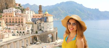 Portrait of young smiling woman with sunglasses in Atrani village, Amalfi Coast, Italy. Panoramic banner view of female tourist i. N her summer holidays in stock images