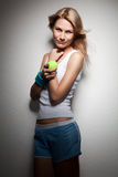 Portrait of young smiling woman with tennis ball Royalty Free Stock Photos