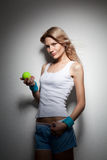 Portrait of young smiling woman with tennis ball Stock Photo