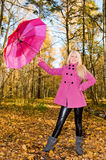 Portrait of young smiling woman with umbrella Stock Photo