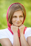 Portrait of young smiling woman wearing kerchief Stock Photo