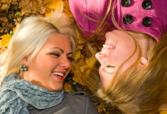 Portrait of young smiling women on the ground Royalty Free Stock Photo